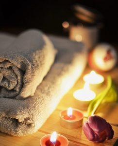 Ready for bath meditation with soft towels and lit candles