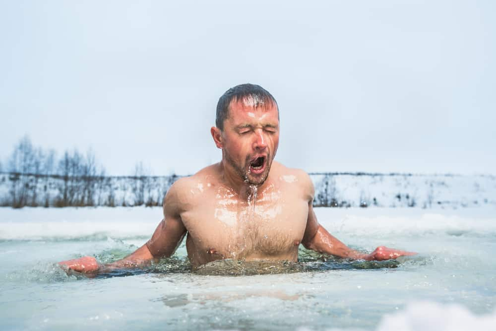 man in natural ice bath