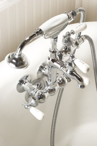 A wall-mounted clawfoot tub filler