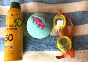 Summer swim bath bomb with goggles and sunscreen