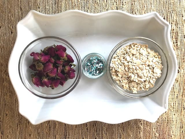 ingredients - dried flowers, glitter and oatmeal