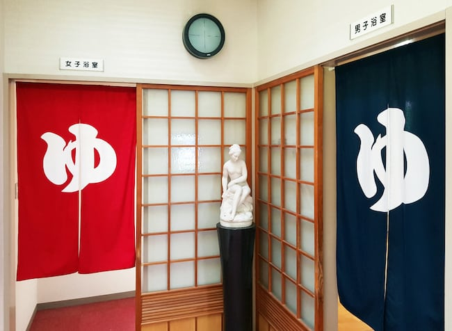 At the Japanese bath house, women enter through the red curtain and men through the blue.