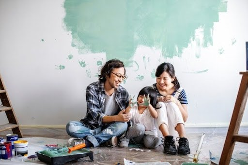 Young couple with young girl during bathroom renovation
