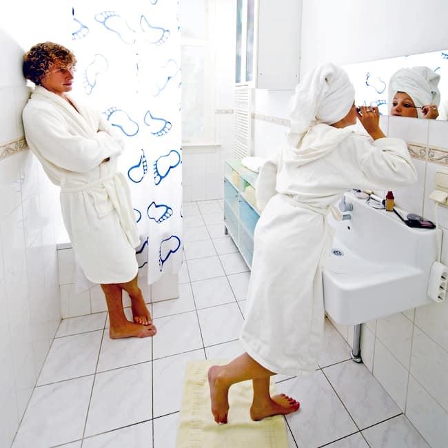 A couple shares the bathroom
