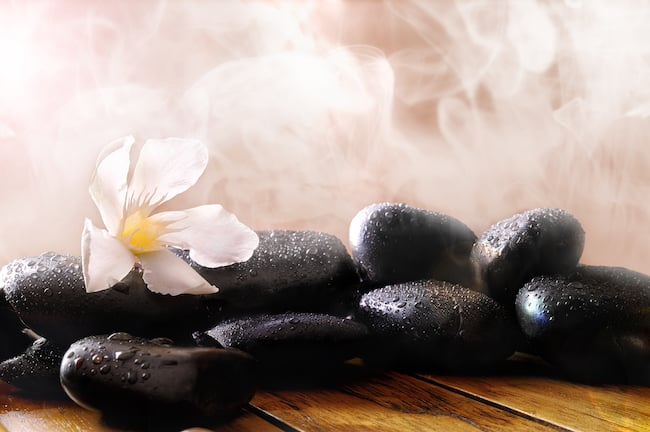 hot stones with steam and flower