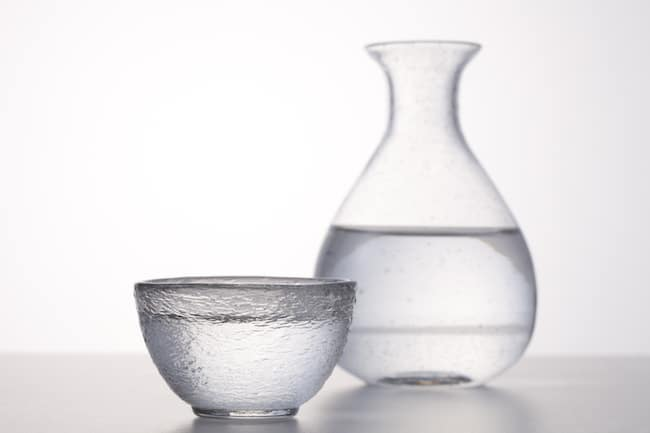 water in a bowl and a vase