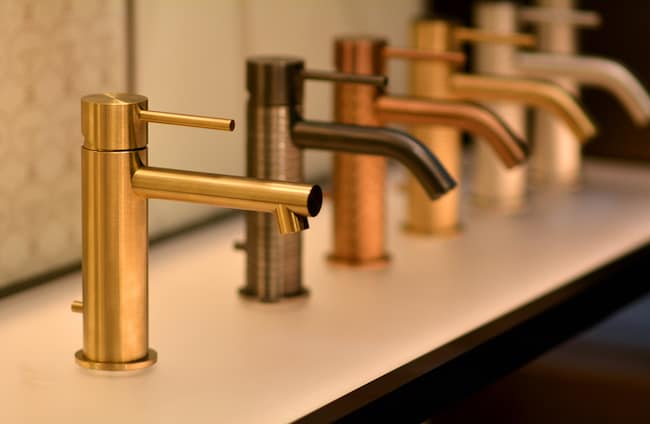A row of faucets made of different metals