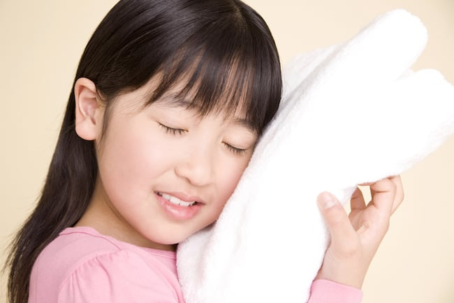A child feels the softness of a bamboo towel