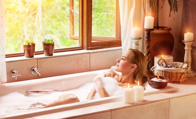 woman in bath beneath open window