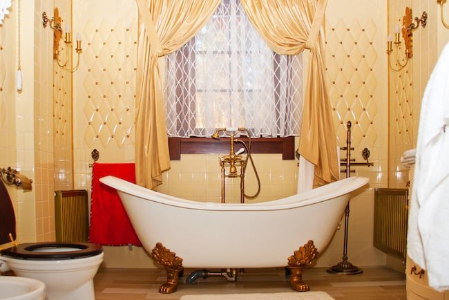 retro bathroom with tub under window