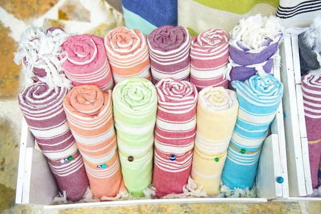 A dozen rolled up pestemal-Turkish towels