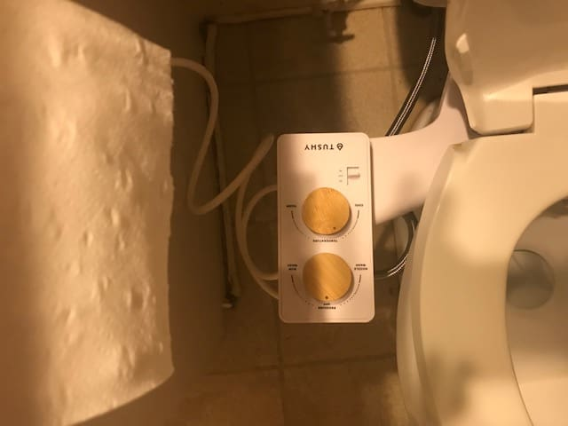 tube connects from warm water valve under sink to TUSHY Spa bidet attachment