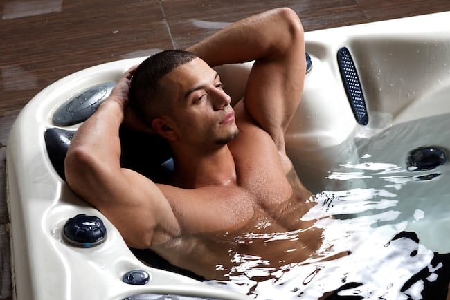 a man relaxes in hot tub