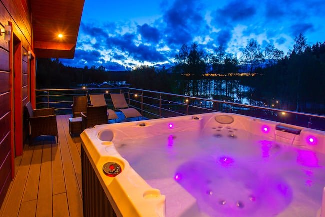outdoor hot tub with purple LED lights