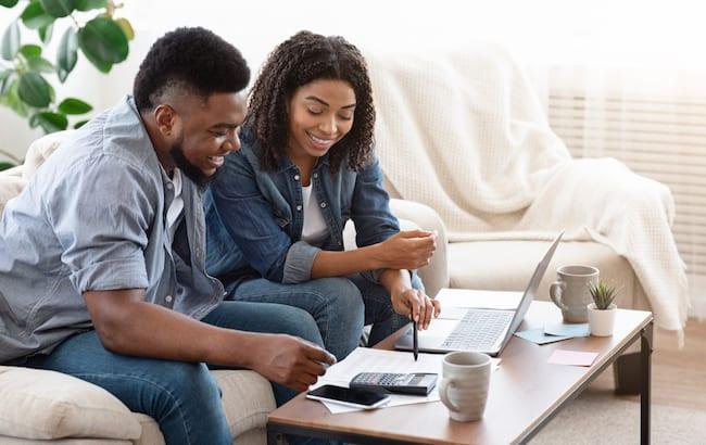 a young couple calculates their bathtub budget