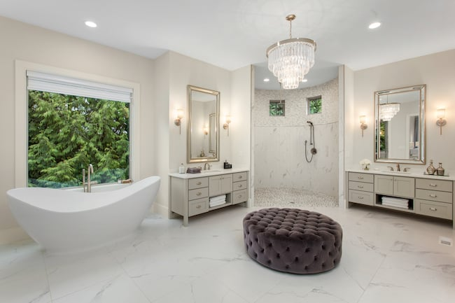 Large bathroom with 2 matching vanities and soaking tub