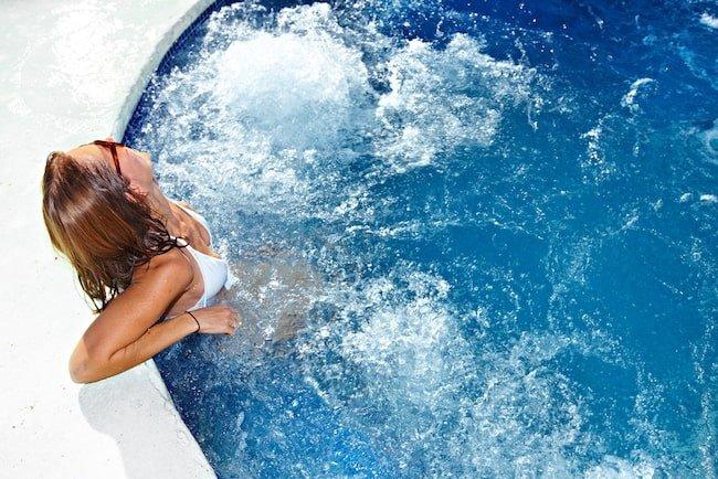 woman soaks in jacuzzi