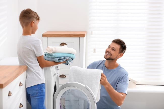 father and son do laundry