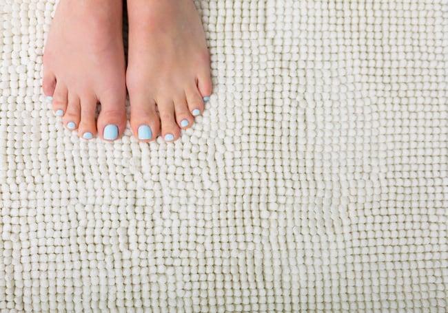 feet on bathroom rug