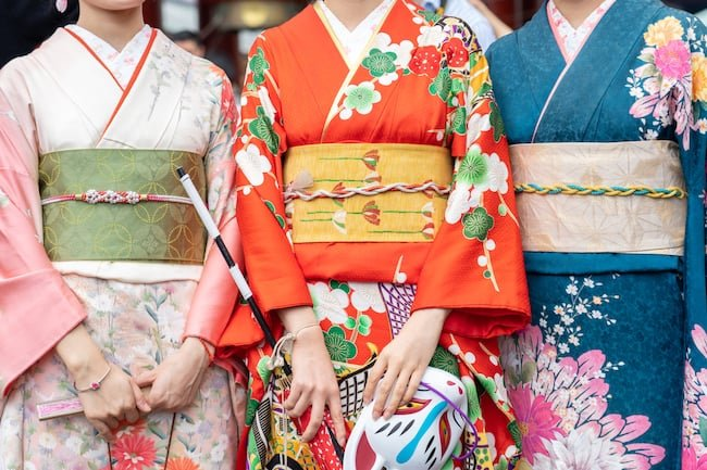 3 women wearing kimonos with obi sashes