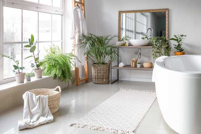 white bathroom rug in large bathroom with freestanding tub