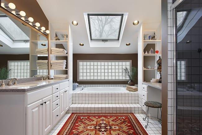 red wool bathroom rug in large white bathroom