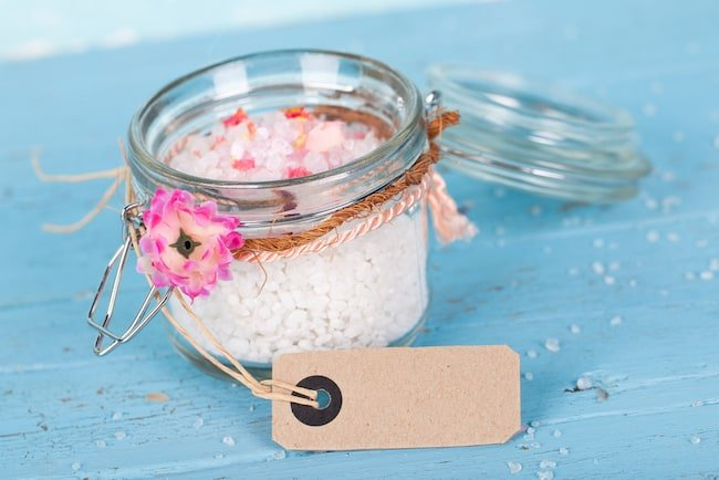 jar of pink bath salts with flower and label