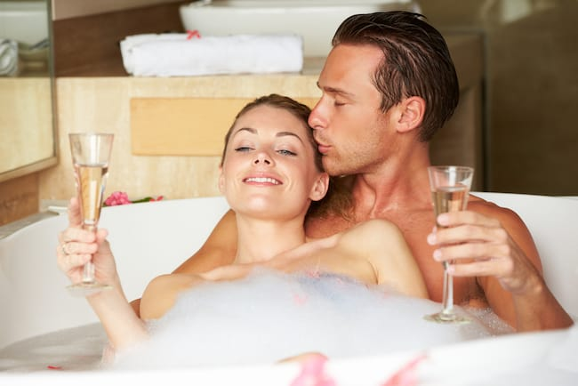 a couple takes a romantic bath together