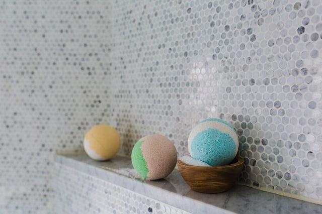 3 bath bombs on a bathroom shelf
