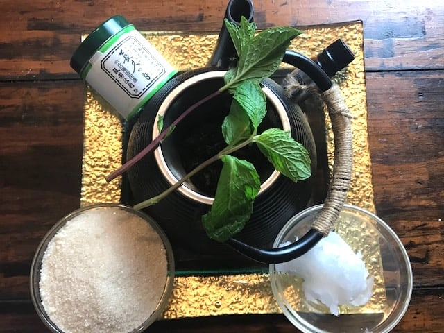 ingredients for DIY sugar scrub with coconut oil and green tea