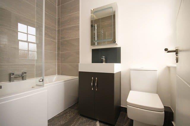 alcove bathtub installed between 3 walls