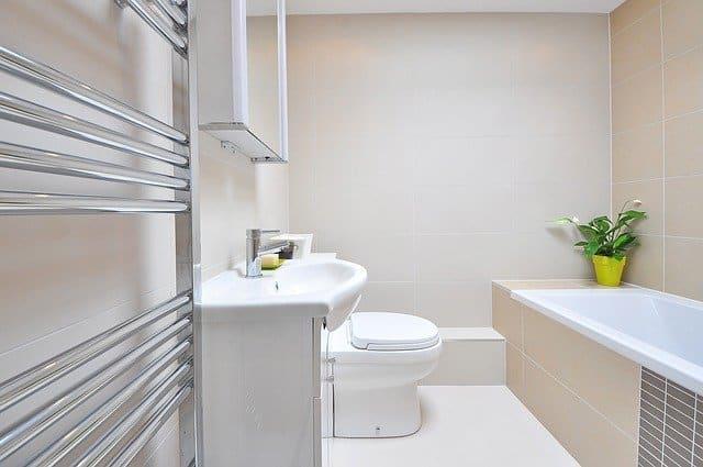 rectangular drop-in bathtub inside ceramic tile deck