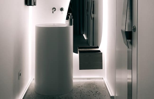 modern pedestal sink placed inches from wall