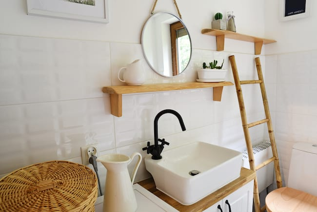 small Zen bathroom decorated in white and natural wood