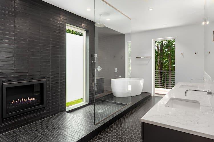 Luxury bathroom with electric fireplace, double vanity and freestanding bathtub