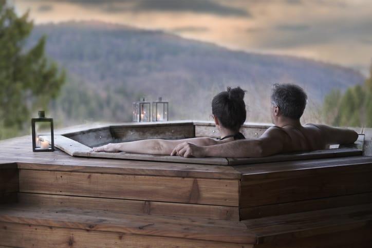 a couple enjoys an outdoor spiritual bath
